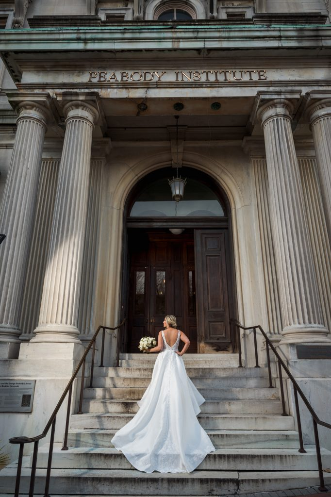 Bride on front steps of the Peabody