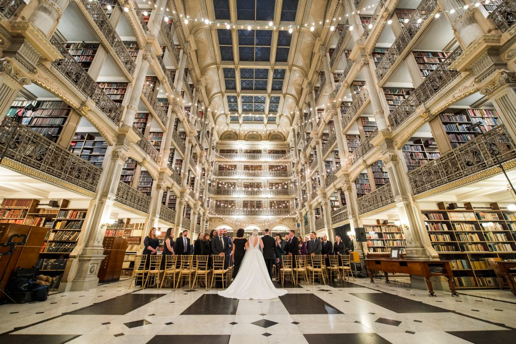 Bride walking down the aisle in the reading room