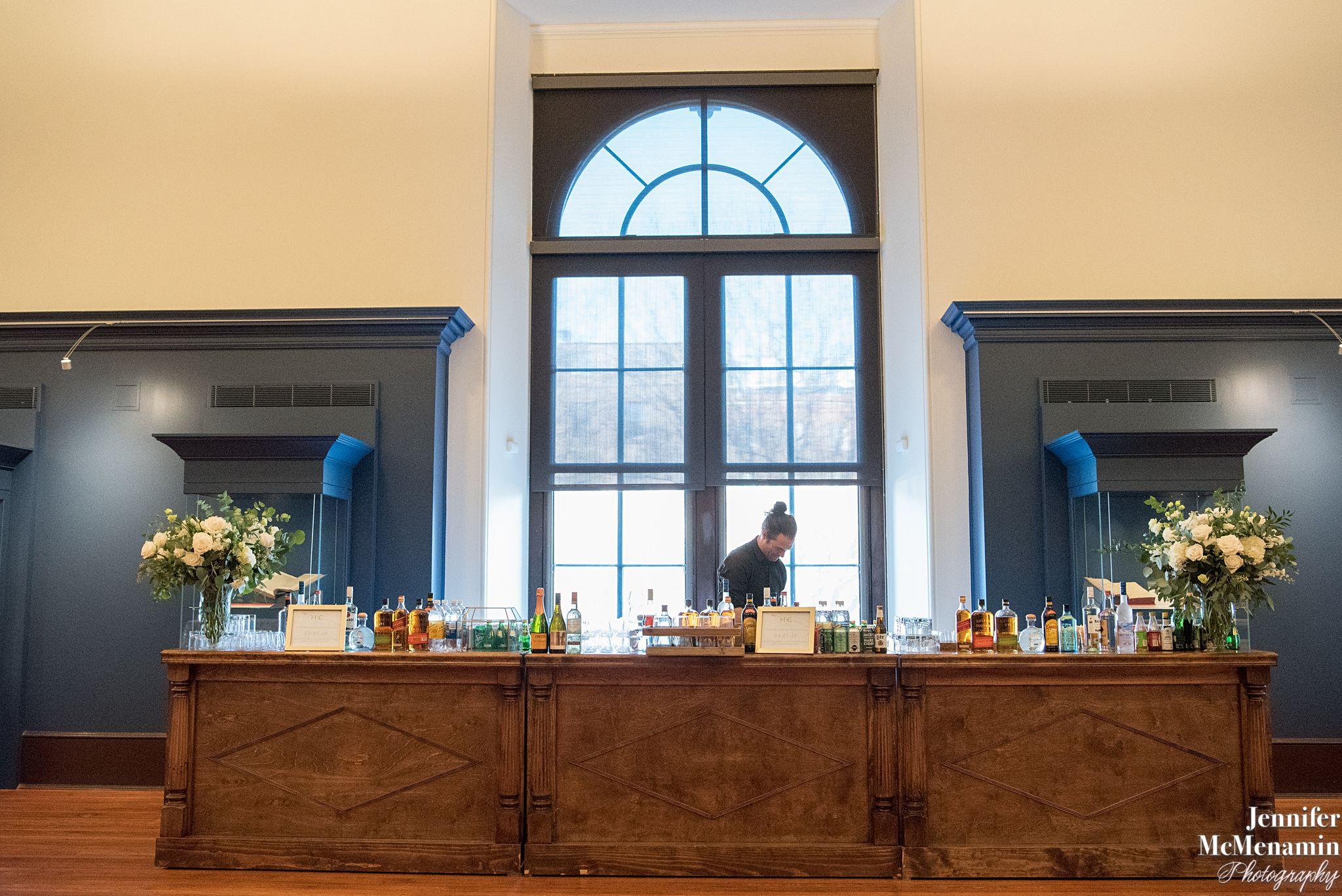 wooden bar set up in exhibit gallery